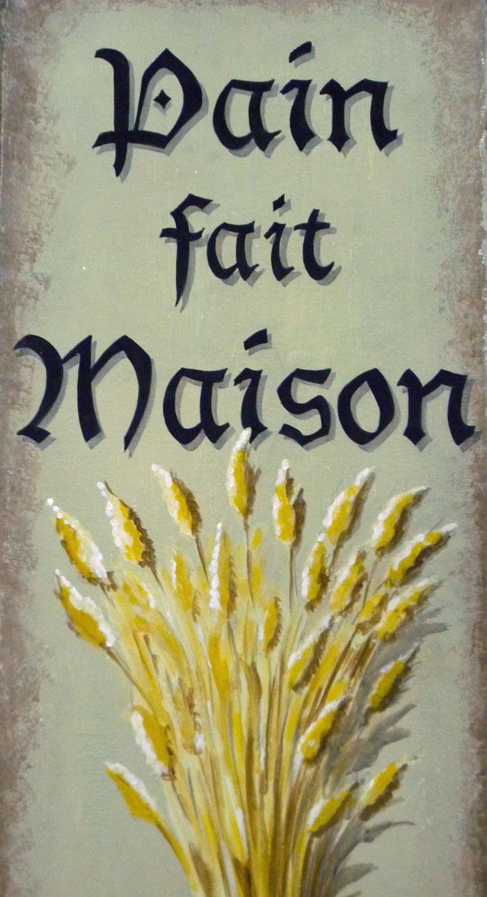 Détail gerbe de blé et typographie peinte