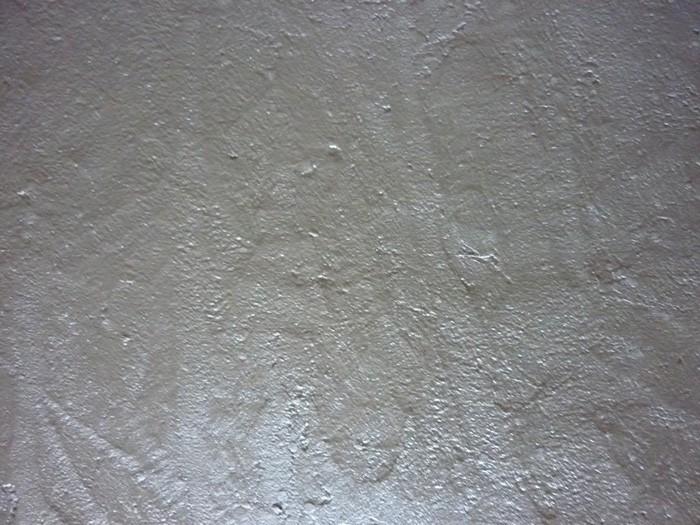 Application sur panneau isorel du béton frais.